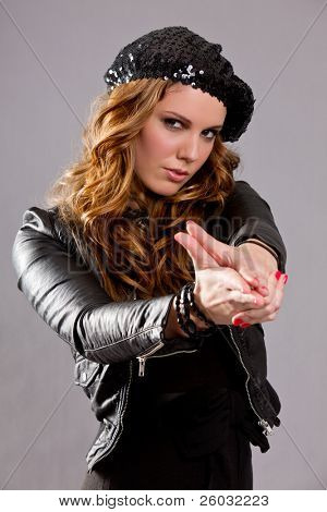 Attractive brunette woman with hand in shape of a gun