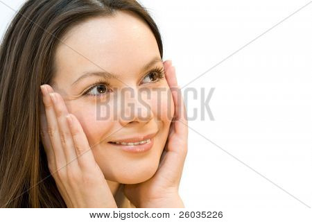 Portrait of the joyful and admired young woman a keeping hands on a cheek. Isolated on white background