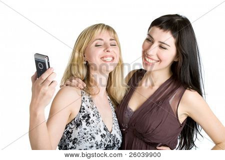 Two teenage girls photographing on mobile phone. Isolated on white background