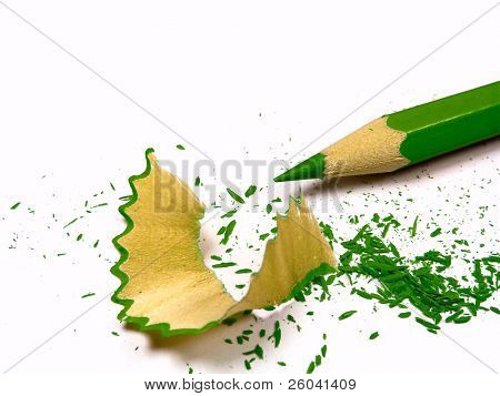Green pencil with sharpening shavings. Isolated on white background