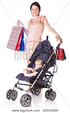 Young mother with baby in perambulator. Isolated on white background