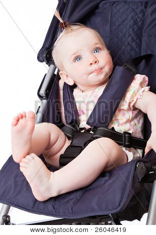 Portrait of baby in perambulator