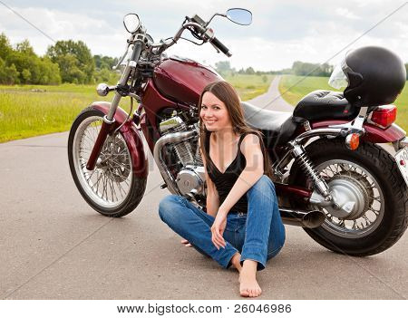Young biker girl on a motorcycle