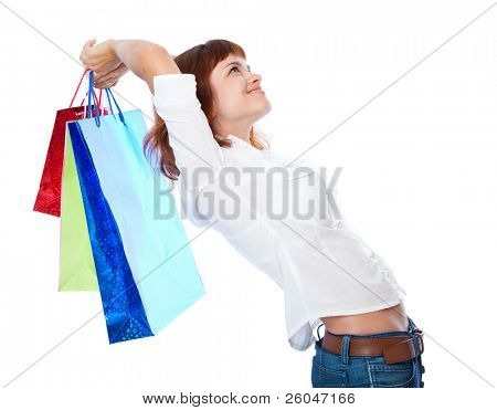 Red-haired teen-girl with three shopping bag. Isolated on white background