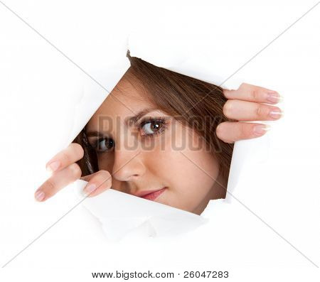 Girl is looking through a hole. Isolated on white background