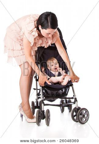 a young woman is standing near her child in a pram. isolated on a white background