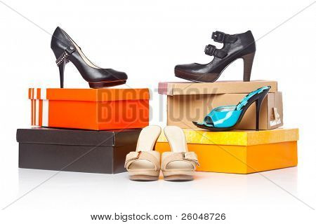 fashion shoes on the boxes. isolated on a white background