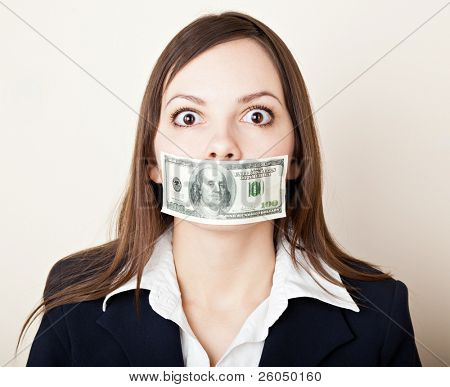 Young brunette woman with 100 dollars on her mouth