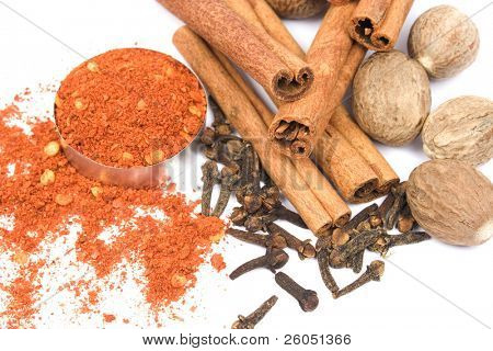 Assortment of spices - cinnamon sticks, nutmeg, cloves and ground red pepper