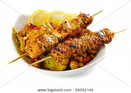 Grilled chicken meat with vegetables isolated on white background