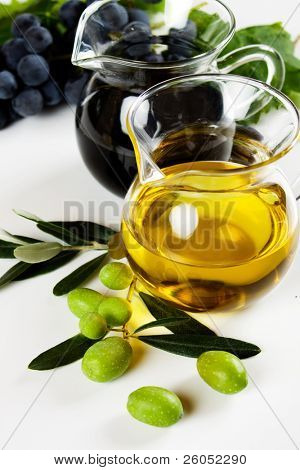 Olive oil and balsamic vinegar on white background