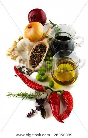 Olive oil and balsamic vinegar with mediterranean spices isolated on white