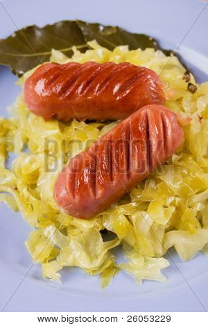 Fried sausage and sauerkraut, traditional german meal
