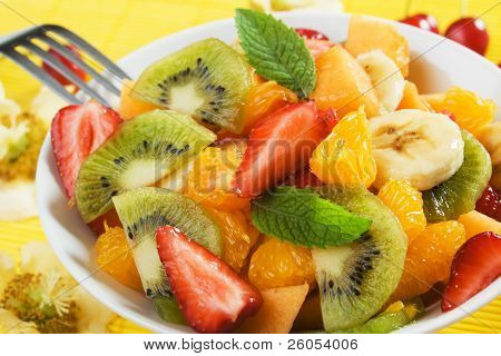 Fresh fruit salad with kiwi, melon, orange and strawberry
