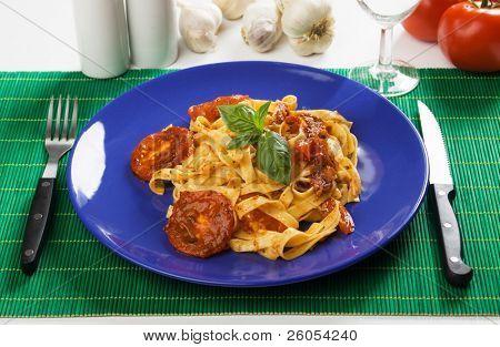 Fettuccine pasta with tomato sauce a la milanese