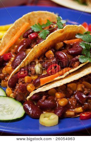Chili con carne burritos in corn taco shells