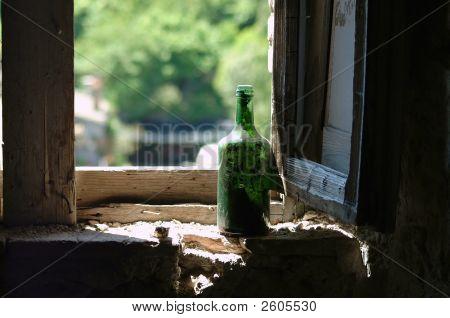Old Green Wine Bottle In Window