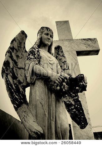 an angel and cross