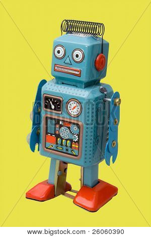 retro robot toy yellow background