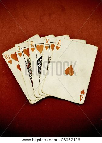 old royal flush on red felt