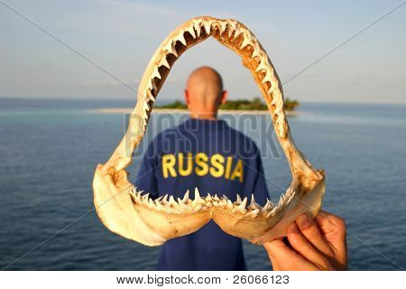 Bald headed diver  from Russia in the shark jaw