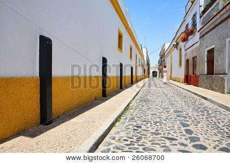 Lonely girl going down the street in the small Spanish town of Jerez de la Frontera
