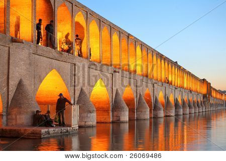 Khajoo bridge over Zayandeh river at dusk with lights, Isfahan, Iran