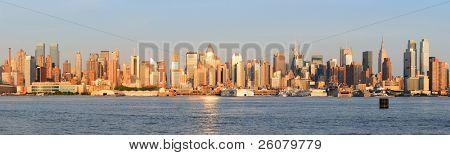 New York City Manhattan midtown skyline panorama at sunset.