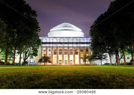 Boston Massachusetts Institute of Technology campus with trees and lawn at night