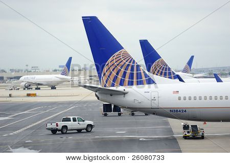 NEWARK, NJ - OCT 5: United Airlines Logo on airplane tail wing at airport on October 5, 2011 in Newark, New Jersey. United Airlines merged with Continental in 2010 as now the world's largest airline.