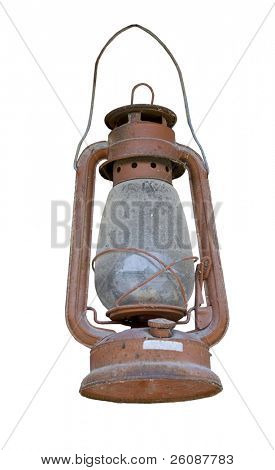 Old dusty oil lamp isolated on white