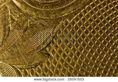 Highly detailed background carved in gold