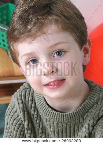 Four year old boy with big blue eyes.