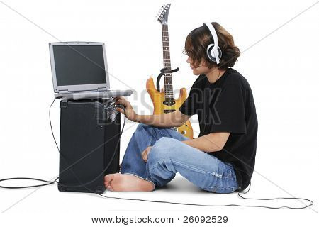 Boy Teenager With Electric Guitar Amp And Laptop.