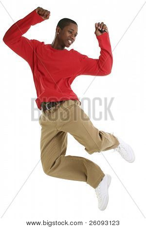 Casual man jumping. Holding car keys. Wearing khakis and long sleeve red shirt. Shot in studio over white.