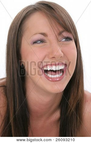 Beautiful eighteen year old young woman laughing.  Great teeth. Shot in studio.