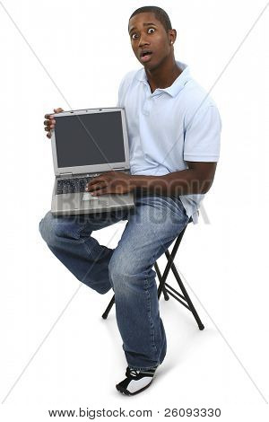 Casual Man with Laptop Computer and Shocked Expression on Face. Shot in studio over white.
