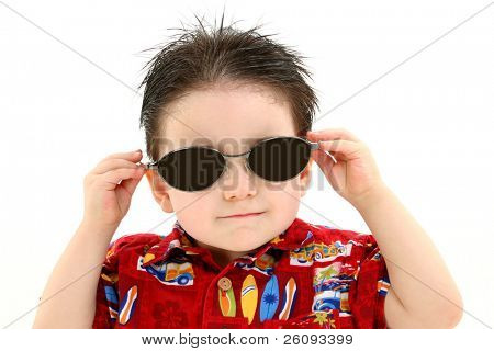 Adorable Boy In Dark Sunglasses And Hawaiian Shirt. Shot in studio over white.