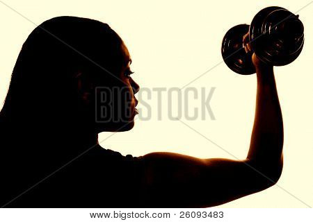 "Beautiful ""African American"" woman in sports outfit working biceps with colorful dumbells."