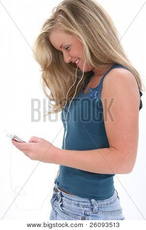 Blonde Teen Girl Listening To Music.  Shot in studio over white.