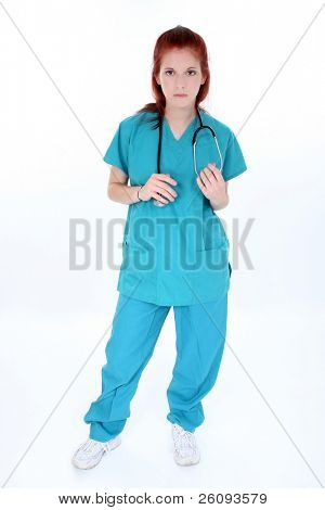 Tired emergency room nurse standing over white.  Young woman in teal scrubs with stethoscope.  Shot in studio.