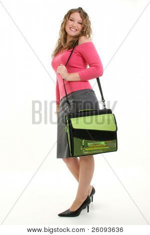 Beautiful 16 year old girl with bookbag.  Shot in studio over white.