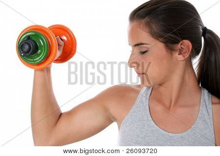 Teen girl lifting hand weights.  Shot in studio over white.