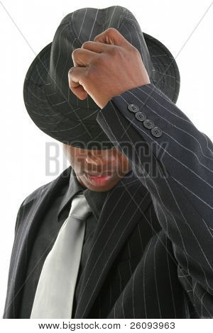 Attractive Young Man In Pinstripe Suit and Hat. Tipping his hat.  Focus on hand and buttons.  Shot in studio over white.