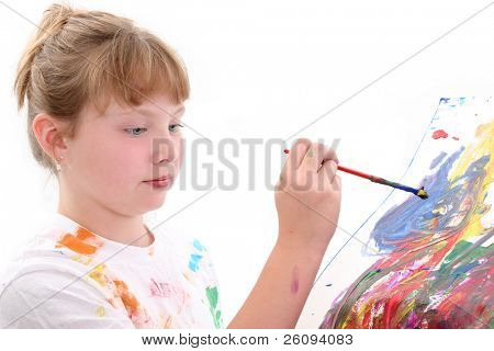 Young girl painting on poster board.