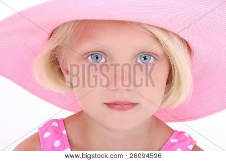 Beautiful Little Girl In Pink Swim Suit And Large Hat. Close-up with serious expression.