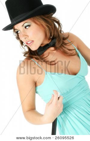 Beautiful young woman in teal formal dress wearing a top hat, bow tie and holding a cane.  Shot in studio over white.