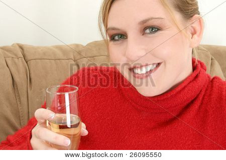 Beautiful young woman with glass of champange.