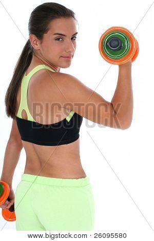 beautiful Teen Girl mit bunten Handweights übermäßigschulter. in schuß weiß.