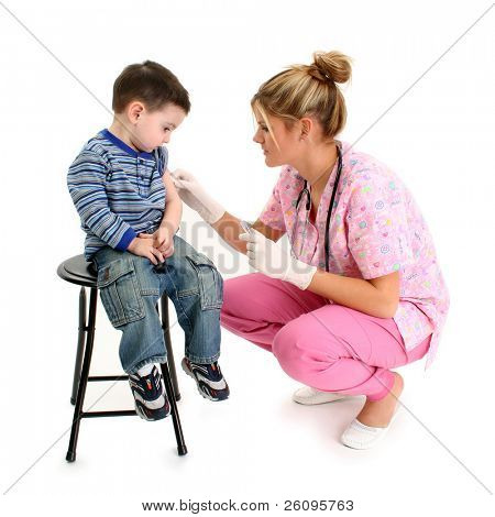 Nurse giving small boy a shot.